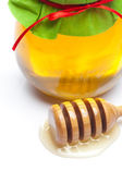 Stick to hohey and jar of honey isolated on white — Stock Photo