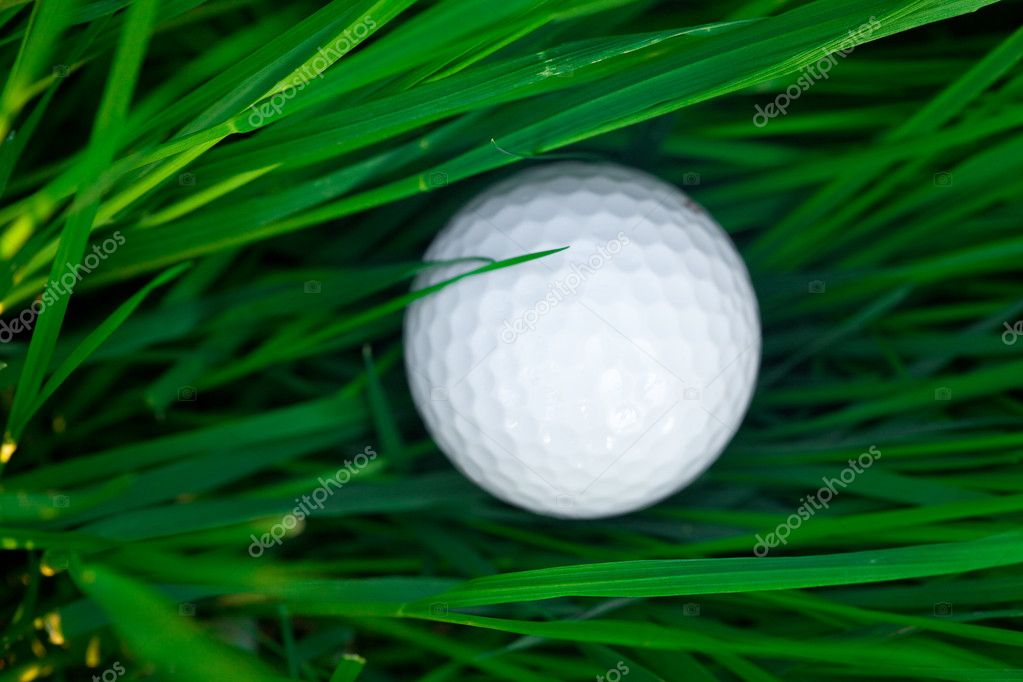 Background of spring green grass and golf ball — Stock Photo #6147953