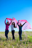 Three young beautiful woman standing with tissue into the field — Stock Photo