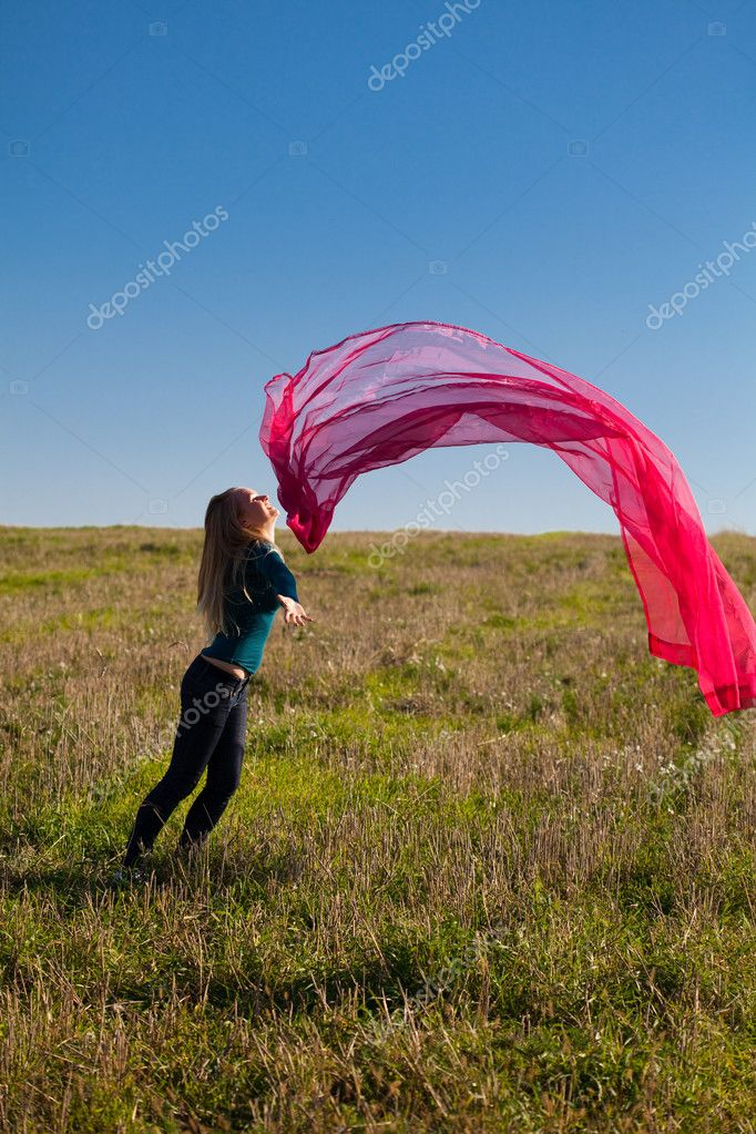 Young beautiful woman jumping with tissue into the field against the sky  Stock Photo #6158659