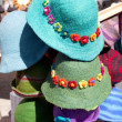 Colorful hats at the fair — Stock Photo
