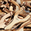Background of wooden slingshots at the fair - Stock Photo