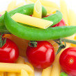Royalty-Free Stock Photo: Tomato, peas and pasta on a plate isolated on white