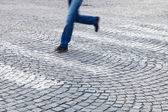 Man running at a pedestrian crossing — Stock Photo
