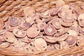 Background of clay ornaments in a basket — Stock Photo