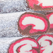 Background of coconut rolls at the fair — Stock Photo