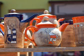 Ceramic teapots at the fair — Stock Photo