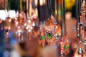 Clay ornaments on the ropes at the fair — Stock Photo