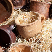Clay pots in the straw at the fair — Stock Photo