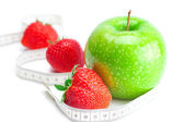 Big juicy red ripe strawberries,apple and measure tape isolated — Stock Photo
