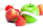 Big juicy red ripe strawberries,apple,peach and measure tape iso — Stock Photo