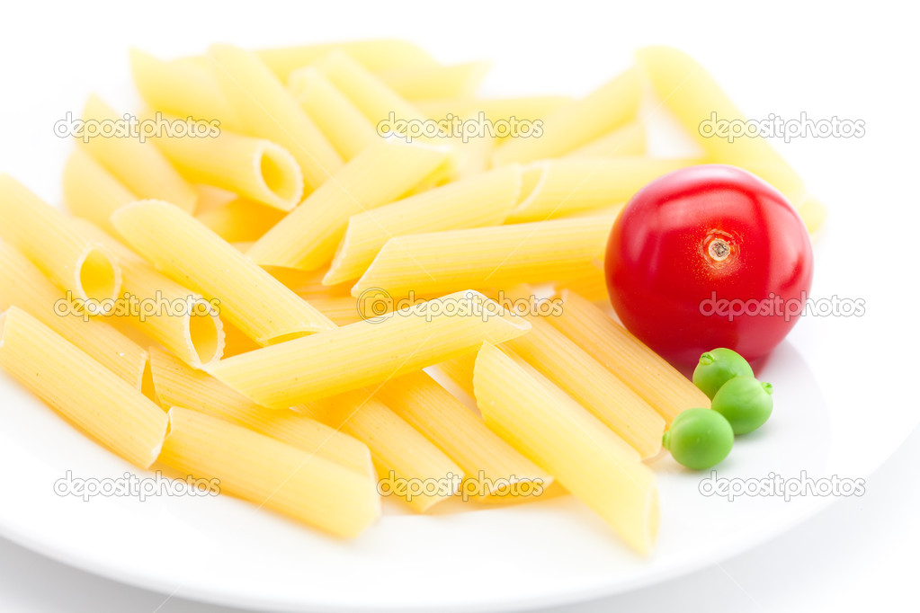Tomato, peas and pasta on a plate isolated on white — Stock Photo #6167989