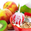 Strawberry, peach, apple, kiwi, fork, milk and flakes in a bowl — Stock Photo