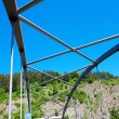 Iron bridge construction against the blue sky — Stock Photo