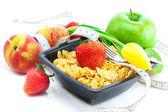 Strawberry, peach, apple, kiwi fruit, tulips,measure tape and fl — Stock Photo