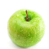 Big green apple with water drops isolated on white — Stock Photo