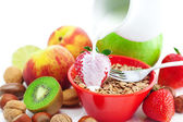 Strawberry, peach, apple, kiwi, fork, milk,nuts and wheat in a b — Stock Photo