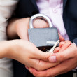 Padlock with the chain in the hands of just married — Stock Photo #6180271