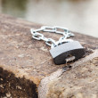Padlock and chain on the parapet — Stock Photo