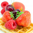 Waffles, cherry, strawberry, apricot and raspberry isolated on w — Stock Photo