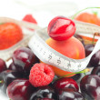Measure tape,strawberry, apricot, cherry and raspberry isolated — Stock Photo