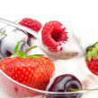 Stock Photo: Ice cream, cherries, raspberries, strawberries and spoon isolate
