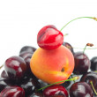 Apricot on background cherry — Stock Photo