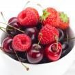 Raspberries, strawberries and cherries in a bowl isolated on whi — Stock Photo #6182924