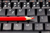 Laptop keyboard and pencil — Stock Photo