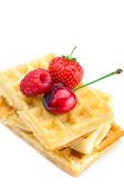 Waffles, cherries, strawberries and raspberries isolated on whit — Stock Photo