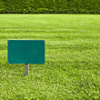 Royalty-Free Stock Photo: Keep of the grass blank sign