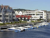 Nordic housing on a river with marina — Stock Photo