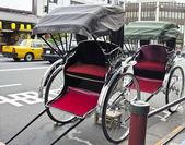Rickshaw in urban style — Stock Photo