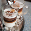 Stock Photo: Two glasses fileed with capuccino in cofee machine