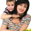 Mother and son portrait with flowers — Stock Photo