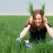 Redhead woman having fun on the green field — Stock Photo