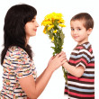 Little boy gives flowers to his mom — Stock Photo