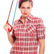Housewife in kerchief with handsaw in hand - Stock Photo