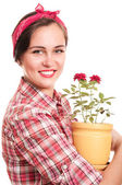 Beautiful happy housewife in kerchief with flower pot — Stock Photo