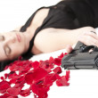 Suicide woman lying on the floor with gun and metaphoric blood — Stock Photo