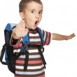 Little boy with backpack pretends kung-fu — Stock Photo #6160660