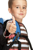 Little boy with backpack shows thumb up sign — Stock Photo