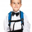 Little boy elementary student with laptop, backpack and bowtie — Stock Photo #6362429