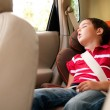 Litle boy sleeps in safe chair in car — Stock Photo #6640977