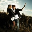 Fashion man and woman in field — Stock Photo