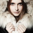 Stock Photo: Girl with fur coat