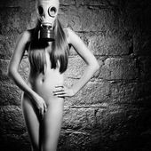 Girl in a gas mask — Stock Photo