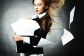 The Girl keeps papers — Stock Photo
