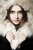 Girl with fur coat — Stock Photo