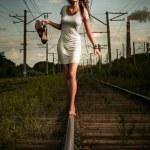 Постер, плакат: On railway tracks